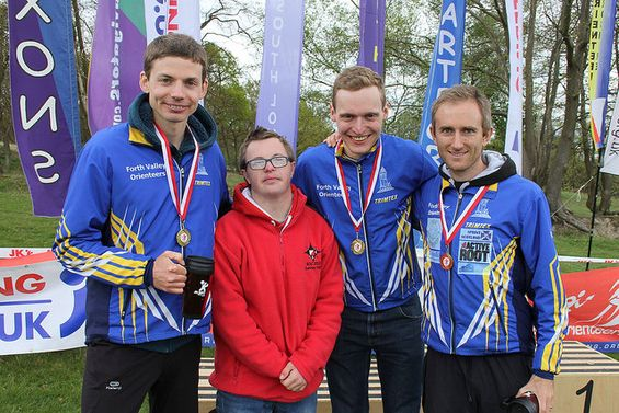 FVO Flyers  (l/r) Chris Smithard, Kris Jones & Graham Gristwood celebrate the Jan Kjellstrom Relay Trophy with a young fan.  (c) Robert Lines